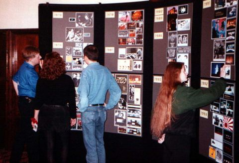 Convention-goers browse the Kraftwerk picture display